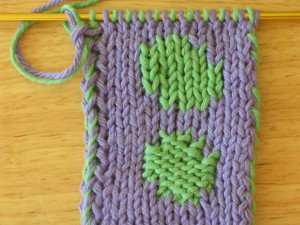 Double knit test swatch: Stockinette stitch verses Reverse Stockinette stitch. Both are made from the same chart